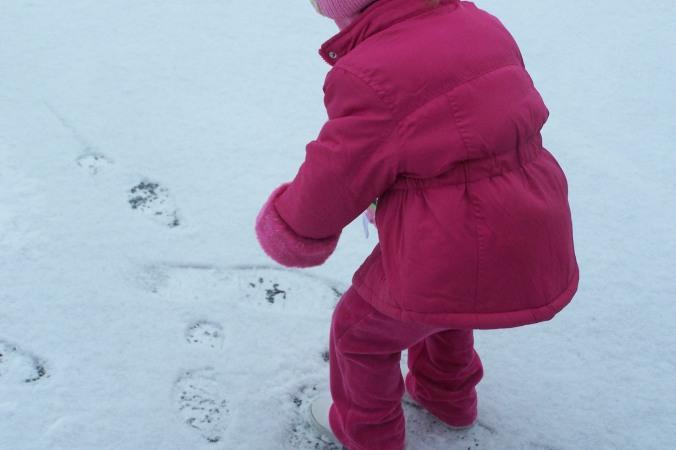 Hannah Making A Snowball